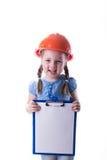 Menina com um capacete da construção Foto de Stock