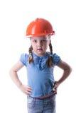 Menina com um capacete da construção Fotografia de Stock