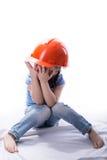 Menina com um capacete da construção Fotografia de Stock Royalty Free