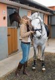 Menina com um cavalo Foto de Stock