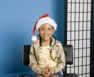 Menina com um chapéu de Santa imagem de stock royalty free