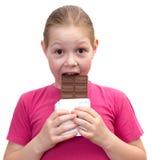 A menina com um chocolate fotos de stock royalty free
