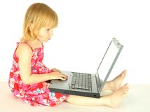 A menina com um computador Foto de Stock
