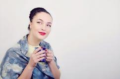 Menina com um copo Imagens de Stock
