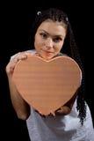 A menina com um coração Imagens de Stock