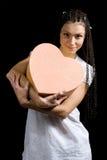 A menina com um coração Fotos de Stock Royalty Free