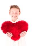 Menina com um coração vermelho em um branco Fotos de Stock Royalty Free
