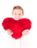 Menina com um coração vermelho em um branco Imagens de Stock Royalty Free