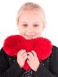 Menina com um coração vermelho em um fundo branco Foto de Stock Royalty Free