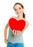 Menina com um descanso heart-shaped fotos de stock royalty free