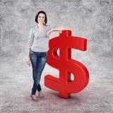 Menina com um dinheiro Fotografia de Stock Royalty Free