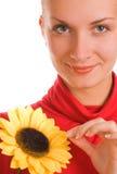 Menina com um girassol Fotografia de Stock