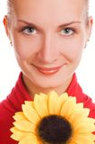 Menina com um girassol Foto de Stock Royalty Free