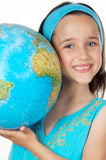 Menina com um globo do mundo fotos de stock royalty free
