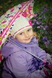 Menina com um guarda-chuva Imagens de Stock Royalty Free