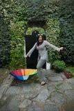 Menina com um guarda-chuva do arco-íris Fotos de Stock