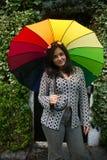 Menina com um guarda-chuva do arco-íris Foto de Stock Royalty Free