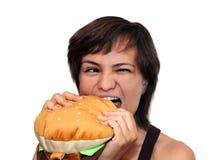 Menina com um Hamburger Imagem de Stock