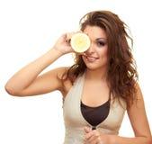 Menina com um limão Foto de Stock
