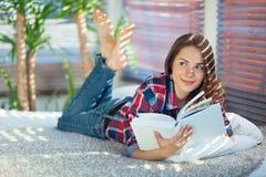 Menina com um livro Fotografia de Stock