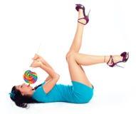 Menina com um lollipop Fotos de Stock Royalty Free