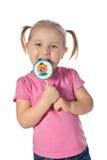 Menina com um lollipop imagens de stock