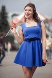 Menina com um lollipop Fotos de Stock