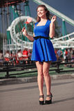 Menina com um lollipop Fotografia de Stock Royalty Free