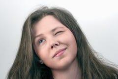 Menina com um olho fechado Fotografia de Stock