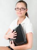 Menina com um portátil Imagem de Stock Royalty Free
