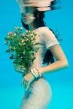 Menina com um ramalhete Foto de Stock