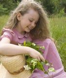 Menina com um ramo do jasmim Imagens de Stock