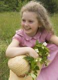 Menina com um ramo do jasmim Imagem de Stock