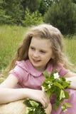 Menina com um ramo do jasmim Fotos de Stock Royalty Free