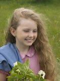 Menina com um ramo do jasmim Imagens de Stock Royalty Free