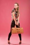 Menina com um saco grande Fotografia de Stock Royalty Free