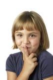 Menina com um segredo Fotografia de Stock Royalty Free