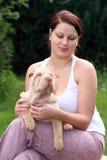 Menina com um sharpei do filhote de cachorro Fotos de Stock Royalty Free