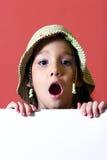 Menina com um suspiro branco Fotografia de Stock