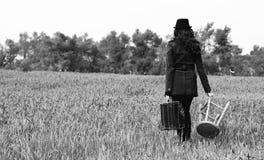 Menina com um tamborete Fotografia de Stock Royalty Free