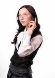 Menina com um telefone celular Imagens de Stock Royalty Free