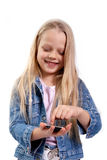 Menina com um telefone do écran sensível Imagens de Stock Royalty Free