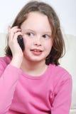 Menina com um telefone móvel Fotografia de Stock Royalty Free