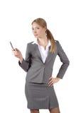 A menina com um telefone móvel Fotografia de Stock