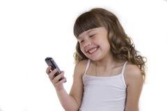 A menina com um telefone móvel Imagens de Stock Royalty Free