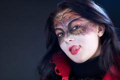 Menina com um teste padrão na face Fotografia de Stock Royalty Free