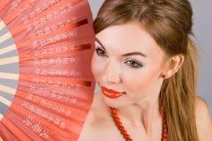 Menina com um ventilador Imagem de Stock Royalty Free
