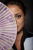 Menina com um ventilador Fotografia de Stock Royalty Free
