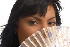 A menina com um ventilador fotografia de stock royalty free