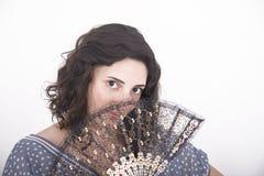 Menina com um ventilador de papel Imagens de Stock